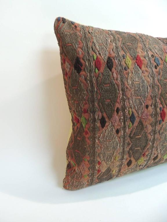 Antique Textiles Galleries: 19th century embroidered Asian long bolster accent pillow. The decorative textile panel has an intricate embroidered pattern with metallic threads embroidered onto linen and is accentuated with stripes and woven design
