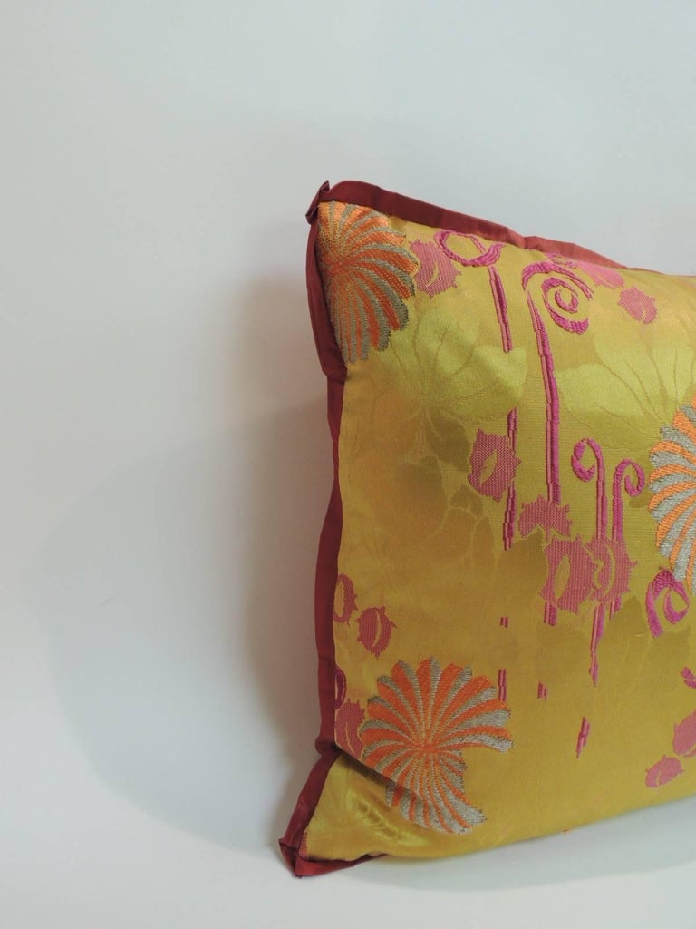 Antique Textiles Galleries: 19th century Japanese bolster pillow with an embroidered textiles panel, metallic threads on silk. The floral pattern on the panel of the accent pillow is in shades of orange, silver and purple on a damask gold background