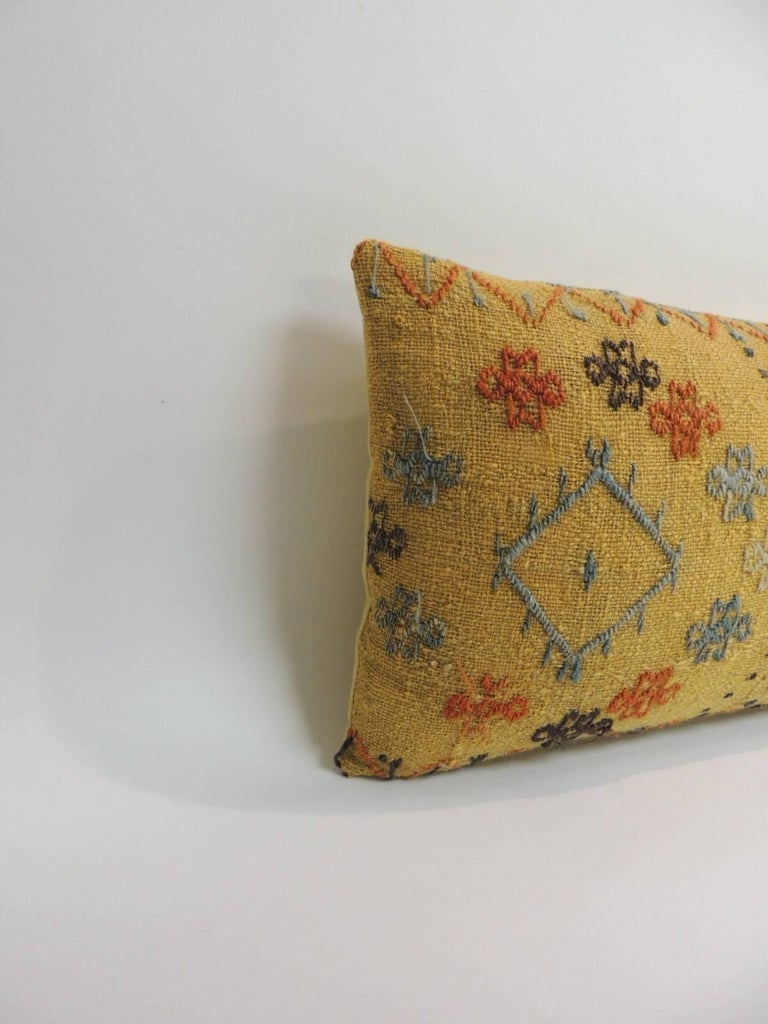 Turkish yellow woven decorative vintage bolster pillow, woven pattern in shades of yellow, black orange and blue with yellow linen backing. Decorative pillow handcrafted and designed in the USA. Closure by stitch (no zipper closure) with custom-made