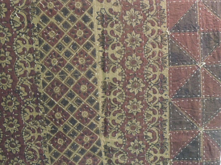 Large vintage quilted Indian Khanta king-size Blanket. In shades of red. brown, tan, yellow, red, deep blue and natural. Khanta quilts alongside jamdani are the pride of Bengal (a geopolitical, cultural and historical region in Asia in the