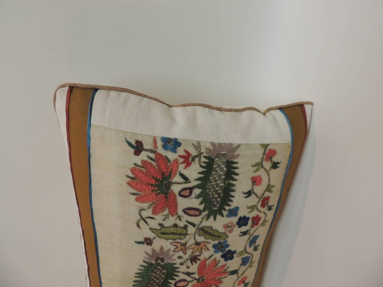 Antique hand-embroidery floral decorative pillow, silk and metallic threads embroidered onto sheer linen. Lumbar Turkish textile pillow embellished with tan cotton frame featuring small silk trims at seams and tan rope cord all around. Decorative