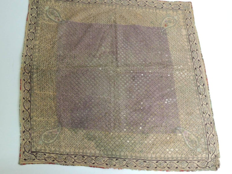 Intricate Indian embroidered cloth/textile with paisley, flowers and vines embroidered on silk with metallic threads and small brass sequins all around. Peach color silk border with purple silk center and scrolling vines border. Size: 27 x 28