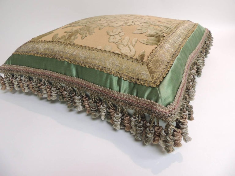 19th century green and gold silk velvet decorative square pillow. The center antique textile panel is framed with an antique metallic trim and embellished with silk tassel trim all around and finished with silk backing. Decorative pillow handcrafted