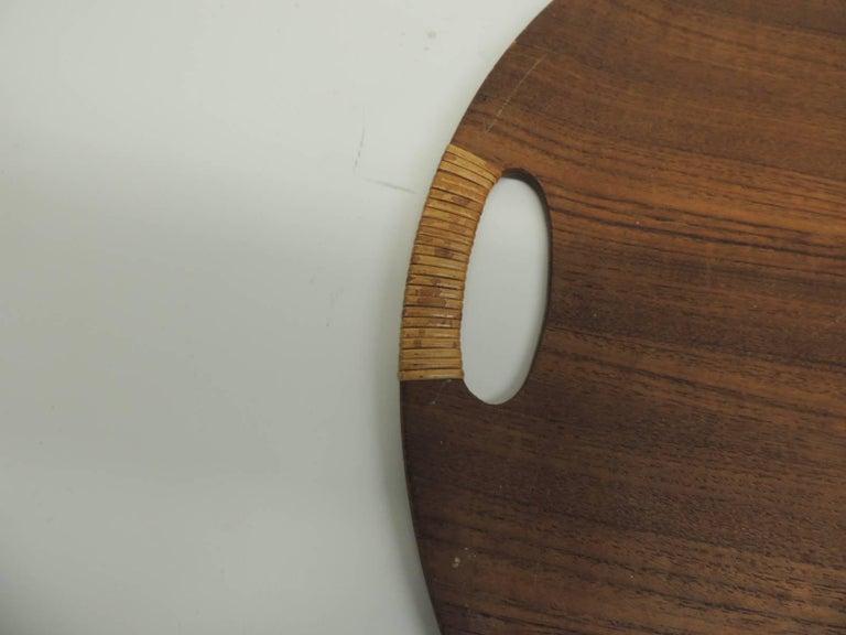 "Vintage Mid-century modern rattan and wood round Danish tray with rattan handles. Round Danish flat tray in wood with rattan handles. Size: 19.5"" D x 0.50""."