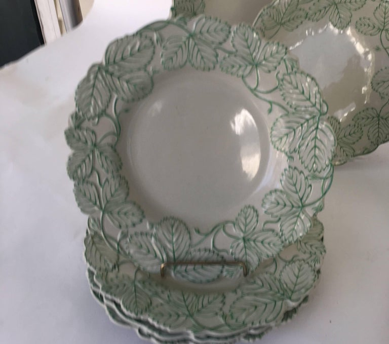 English green and white 19th century Majolica porcelain dessert service with strawberry leaf border.