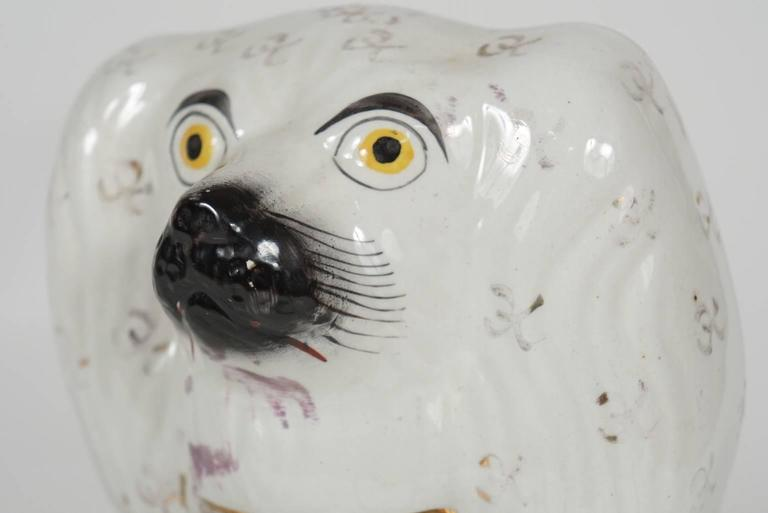 Pair of very similar Staffordshire figures of handsome porcelain seated Spaniels. Large scale doggies. 19th century English porcelain.