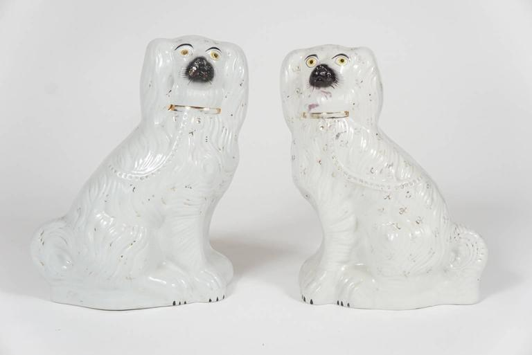 English Pair of Similar Staffordshire Porcelain Spaniels For Sale