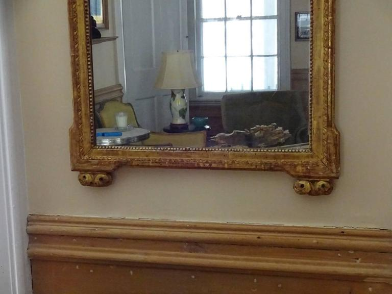 Handsome Louis XVI style giltwood rectangular mirror with bead and stylized leaf tip borders. Nice size.
