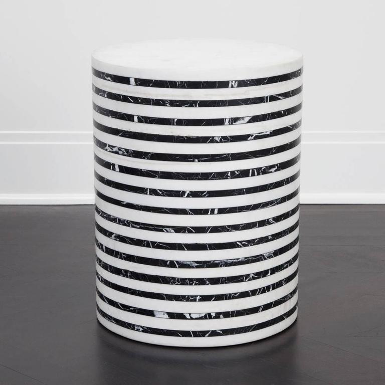 Inspired by Kelly's love for exploring sculptural function and form in her favored black and white fine-striped pattern, this solid marble stool is made from natural, hand-carved marble. The bold lines of honed marble and the simple modern