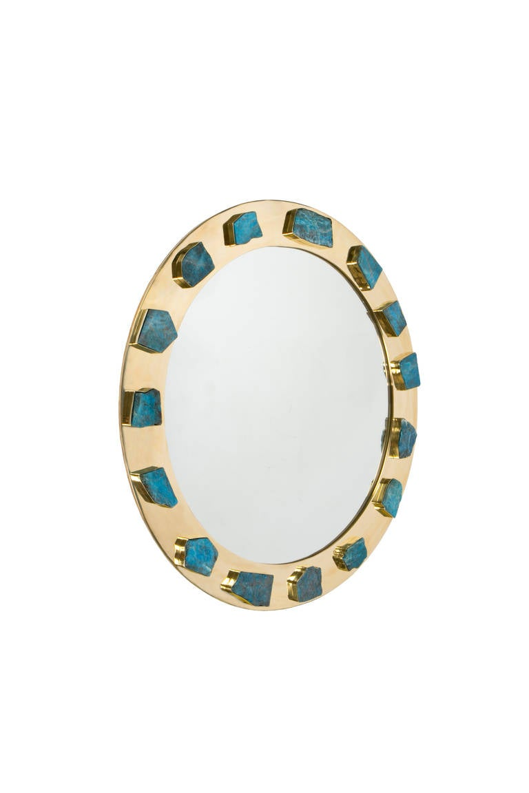 This superluxe un-lacquered bejeweled brass frame is adorned with hand set blue-green apatite stones, placed by Kelly to create a timeless design that expresses your unique style.