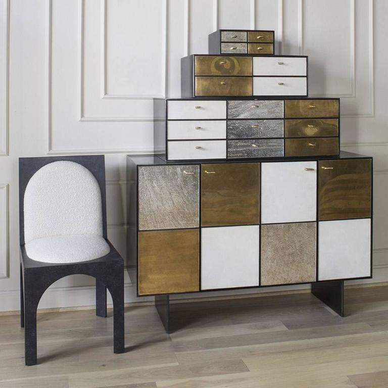 The Huntley cabinet is composed of a blackened stainless steel cabinet body and four doors revealing moveable interior shelving of solid walnut. The tri-level pyramid shape features walnut drawers of beautiful craftsmanship with no after mark