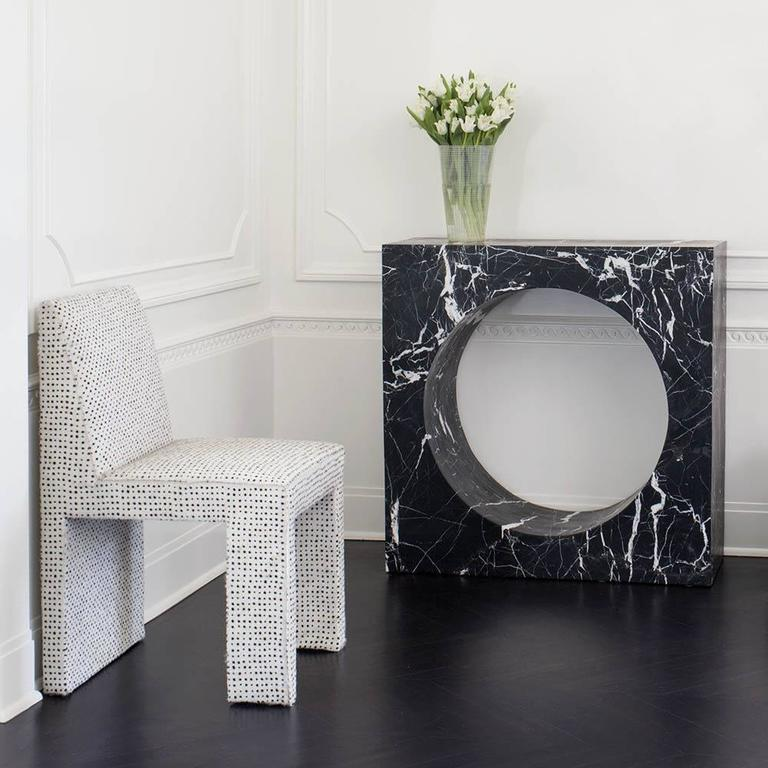 Carved from a solid piece of marble, the Selby console, is geometric and bold. This console perfectly compliments any setting with it's sculptural and modern vibe.