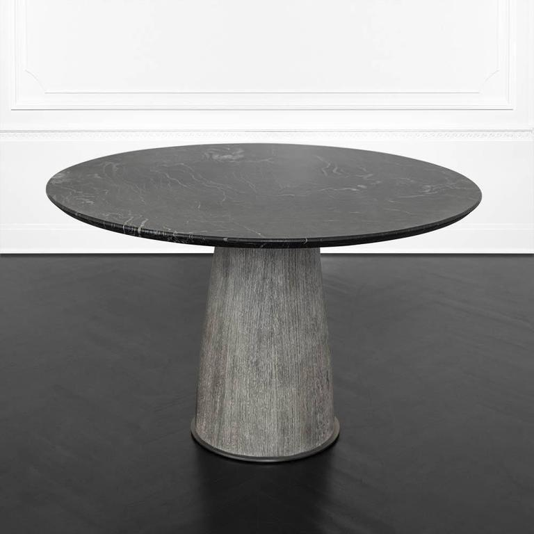 Composed of a solid wire brushed cerused wenge base with a brass foot and collar in burnished bronze patina, the Camden table joins Kelly's affinity for raw, organic materiality and Classic silhouettes. The top is a reversed beveled edge of honed