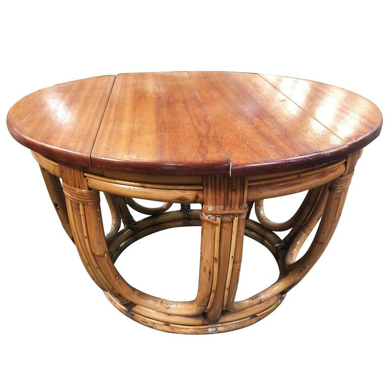 Circular Rattan Coffee Table, Circa 1940. This Rare Rattan Table Features A  Unique Stack