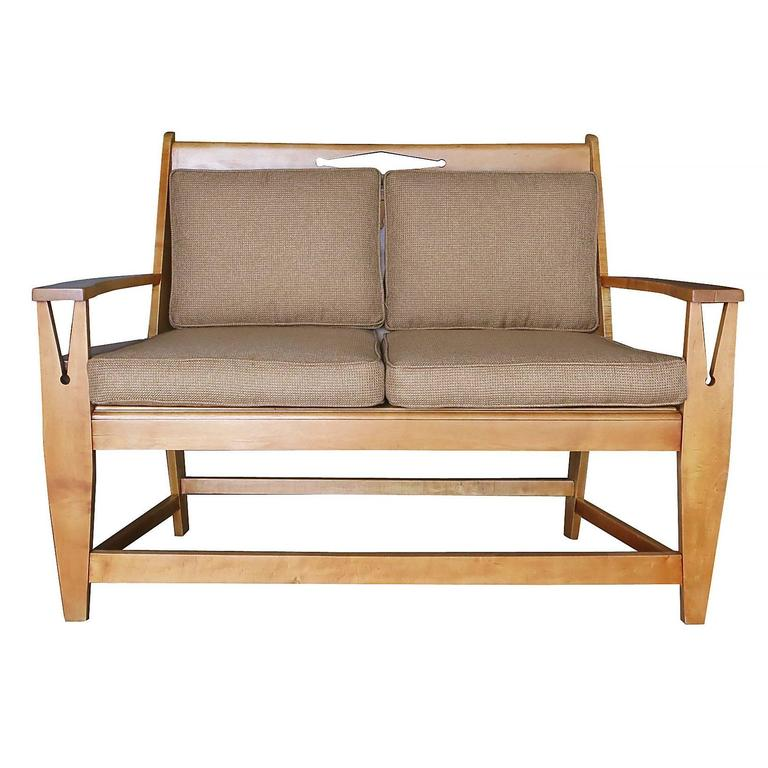 Blonde Wood Sofa with Clothespin Shaped Accents 2