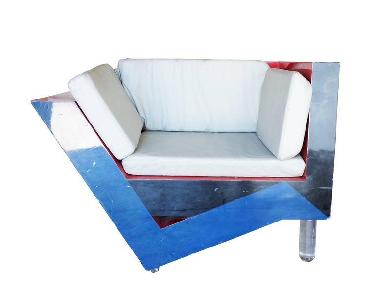 Memphis inspired asymmetric sculptural lounge chair with unique tri-color design and acrylic legs.   This chair appears to be Italian in design with the same quality of original Memphis pieces.