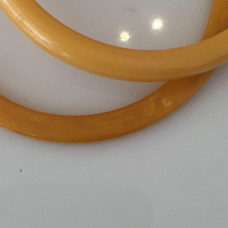 North American Set of Two Art Deco Butterscotch Amber Bakelite Bangles Bracelets For Sale