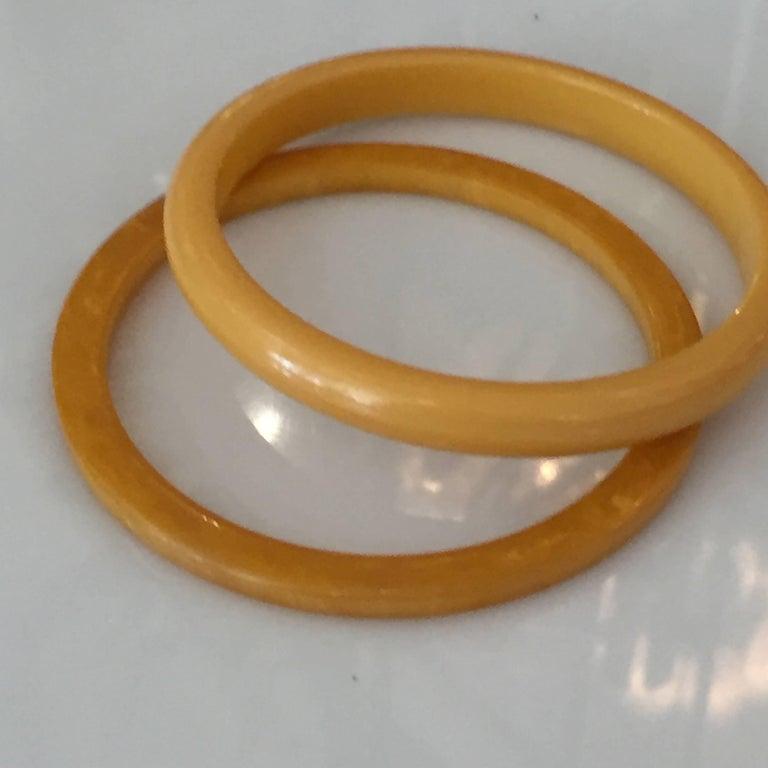 Mid-Century Modern Set of Two Art Deco Butterscotch Amber Bakelite Bangles Bracelets For Sale