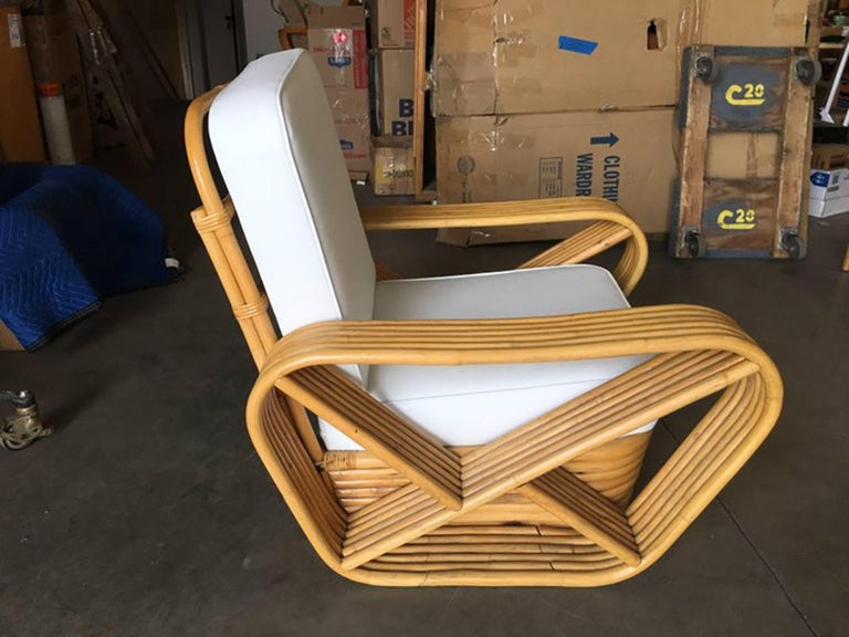 Six strand square pretzel arm rattan occasional chairs with stacked base in the manner of Paul Frankl, pair.   New custom or original cushions in white Naugahyde or C.O.M. (Costumers Own Material) are included in the price. Simply supply the