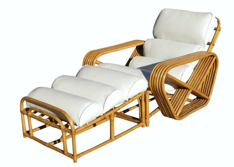 Designed in the manner of Paul Frankl, this restored six-strand, rattan lounge chair features square pretzel arms with a matching fitted ottoman.  Please note: This listing is for a single chair and ottoman (2 pieces)  Measures: Lounge chair- 29