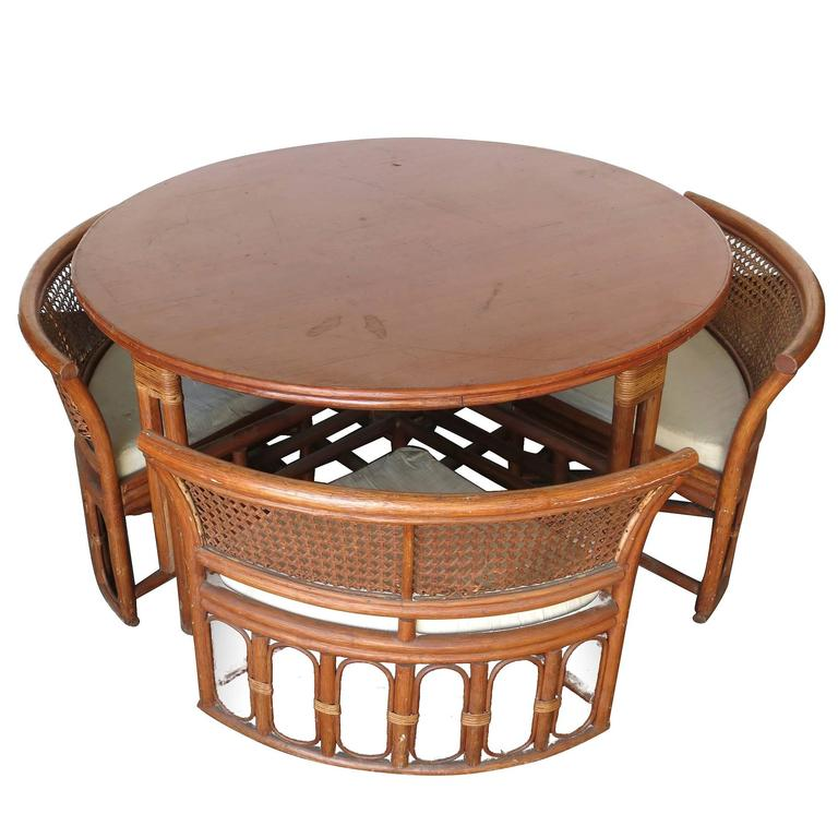Rattan and wicker dining coffee table with hidden chairs for Round dining table with hidden chairs