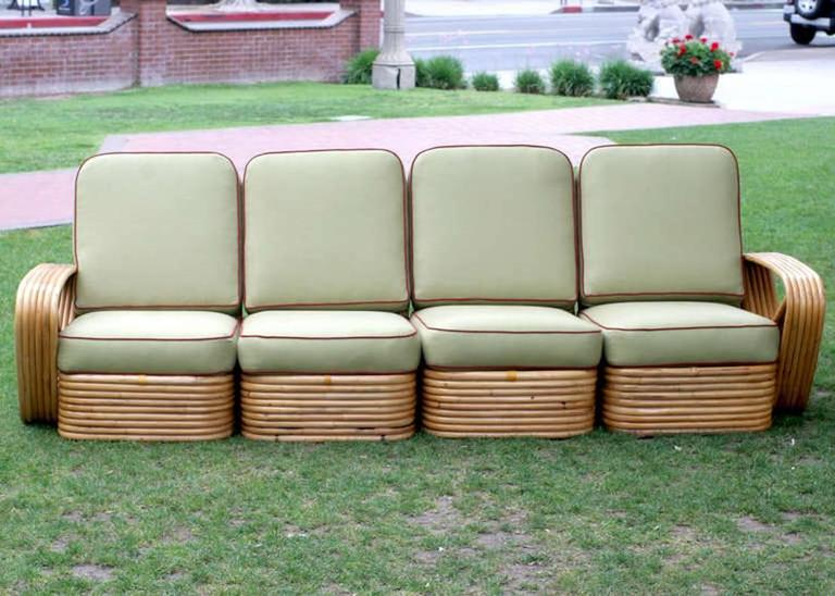Square pretzel rattan sectional sofa designed by Paul Frankl. This sofa features a stacked rattan base with six strand square pretzel arms and is divided into a four personal sectional.  Please inquire about additional pieces