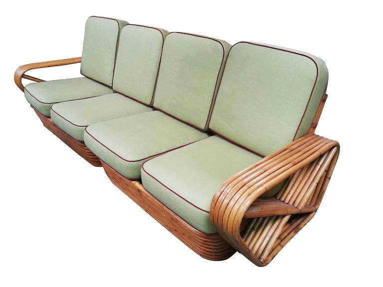 Square pretzel rattan sectional sofa designed by Paul Frankl. This sofa features a stacked rattan base with six strand square pretzel arms and is divided into a two pieces making a four personal sectional.  Please inquire about additional pieces