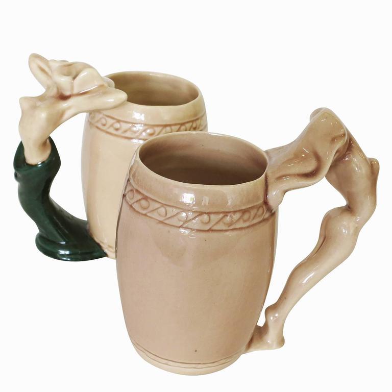 Ceramic female nude mug pair made by the Laguna Beach, California pottery artist Dorothy Kindell known as the
