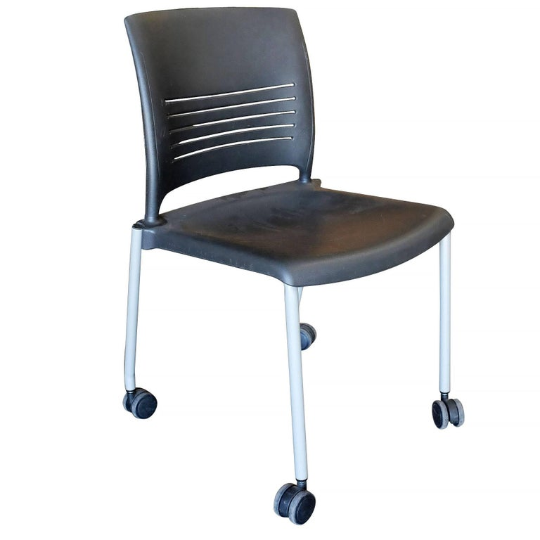 Set of 14 rolling side or desk chairs with plastic seat and powder coated steel legs, designed by Giancarlo Piretti for Strive.  Contact us if you would like a different qaunity.