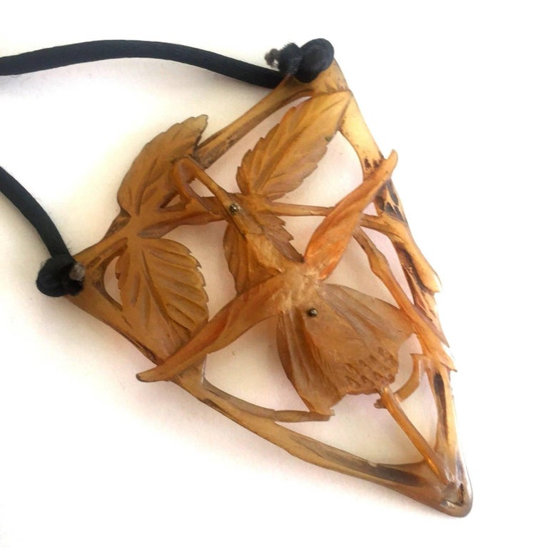 Large Art Nouveau hand-carved orchid tortoiseshell pendant - the detail is exquisite. Tiny pins down the center of the pendant stabilize the piece.  circa 1890, Paris  Measurements: Top to bottom 3