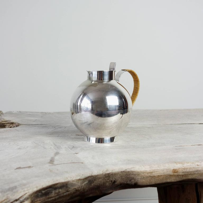 A beautiful and extremely collectible decanter by the Swedish Sylvia Stave, who designed for C.G. Hallbergs until 1940. She had a brief and lauded career, and created a body of work known for its elegant austerity. Her silver designs are in the