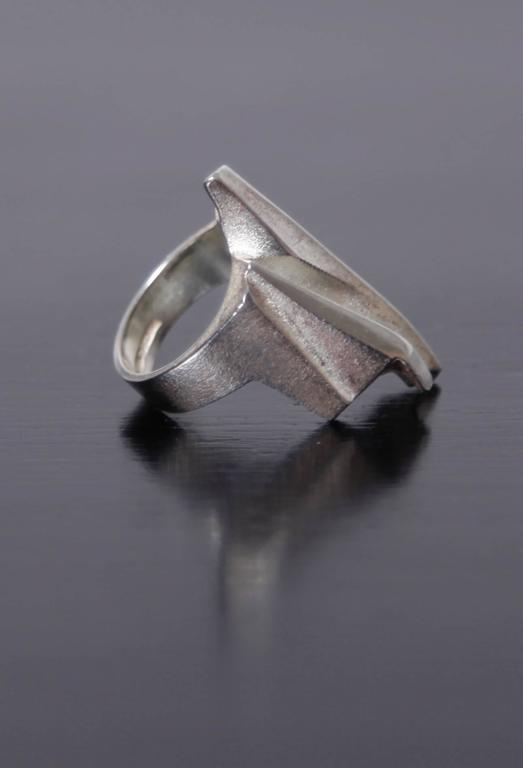 Weckström is a sculptor whose collaboration with fellow Finn Pekka Anttila resulted in the creation of Lapponia jewelry in 1963. Weckström approached jewelry as wearable art, the organic forms inspired by the Finnish landscape. 'Krupp' is one of