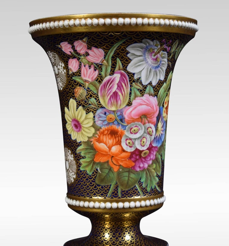 A fine Regency period Spode porcelain spill vases. Of trumpet form with white beaded pearl bands and decorated with painted flowers and fruit on a solid gold background.