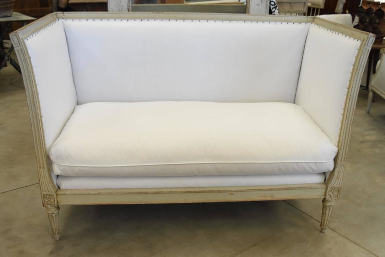 This super chic Napoleon settee from France has been newly upholstered in muslin and has a single down filled cushion. It's modern clean lines go in any decor.