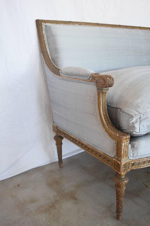 French Louis XVI has always been one of my favorite styles. Whether you want an dressy, casual, modern, or traditional look, it always works. This one is in great condition. It's hand-carved, the gilt is original and there is a little wear on the