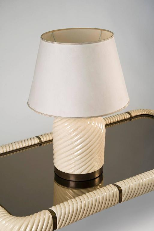 Table lamp designed by Tommaso Barbi, Italy, 1970. Spiral ceramic structure with brass base, fabric shade. The internal part is marked and labeled. Very good original conditions.