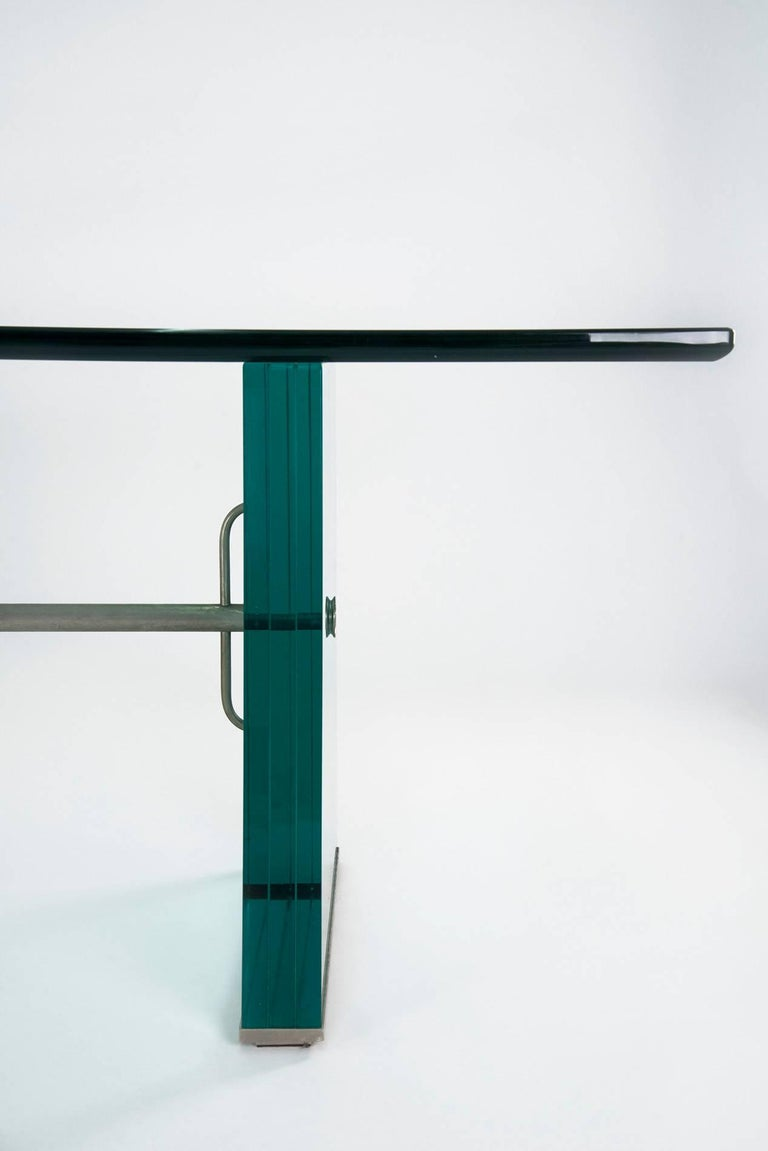 Extraordinary and extremely rare dining table designed by Pietro Chiesa for Fontana Arte in circa 1934. Nickel-plated metal feet and central beam, structure in massive and thick glass in a beautiful shade of green, beautifully cut-glass top. Good