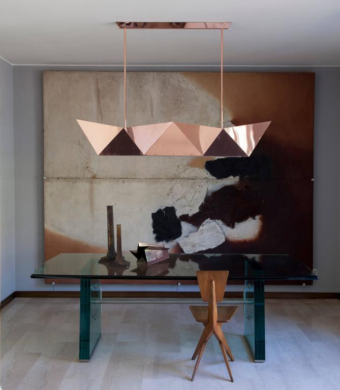 Deriva is a hanging lamp with direct and indirect LED light, an evolution of the ceiling light fixtures especially designed for Fragile's new location in the centre of Milan. It was designed by Alessandro Mendini for Fragile Edizioni on the occasion