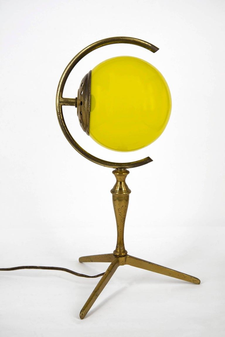 "Pair of graphical table lamps manufactured in Italy in the 1950s. Brass structure, red and yellow ""incamiciato"" Murano glass spheres. Good original vintage conditions."