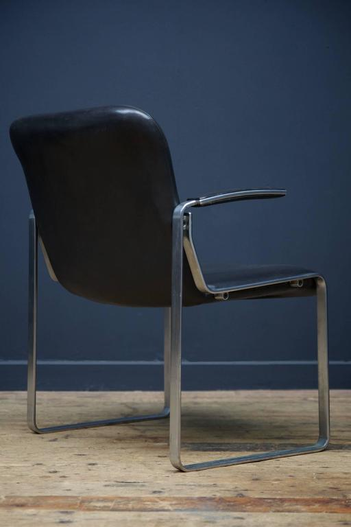 Pair of black leather and extruded alloy open armchairs exceptional