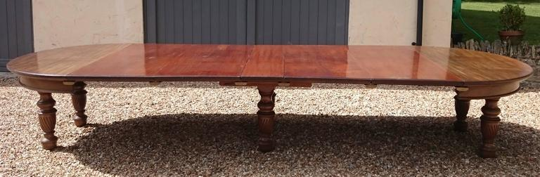 This antique dining table is exceptionally versatile and extremely well made. The top is made of huge sheets of the finest mahogany, the legs are made from single pieces of solid mahogany and even the mechanism is made from dense grained mahogany.