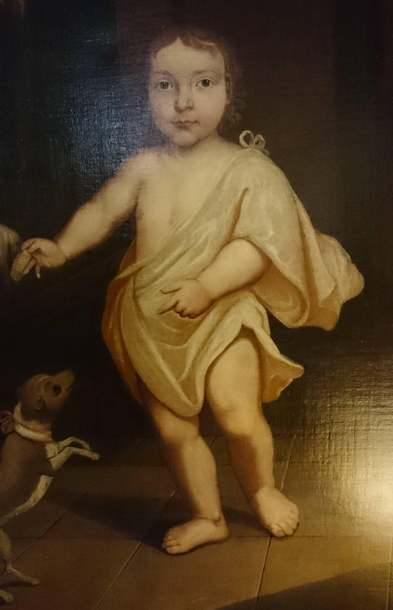 18th century primitive antique oil painting of aristocratic child with dog. This sort of painting is said to have been painted retrospectively to show a wealthy individual as a child, presumably in a situation more grand than the one in which they