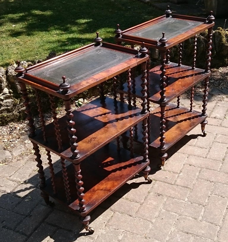 Very fine quality pair of antique walnut whatnots. This pair of whatnots are very well made with generous barley twist columns and wonderfully well figured walnut show wood. The tops are covered with lovely old skiver which might well be the