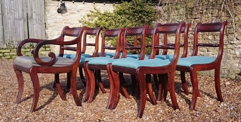 Set of 9 early 19th century Regency mahogany antique dining chairs. This set of chairs can be thought of as a set of eight chairs with one extra or a set of nine. If ten chairs are required then a similar carver can be found or an identical one can