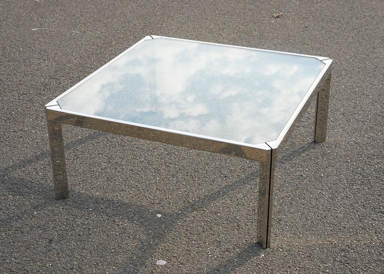 Bright, mirror-like polished surface accentuated with distinctive, blackened reveal spacers along each corner. Original, thick plate glass top inset into frame. All in good vintage condition with light surface wear. Solid, high quality construction