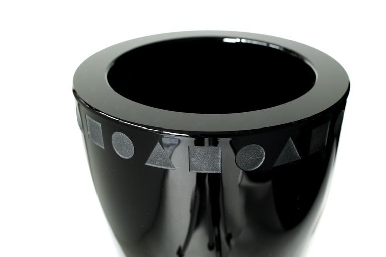 We offer free curbside viewing of this item to the five boroughs of New York City.  Deep, glossy black crystal in elegantly minimal form with thick, heavy walls, etched geometric pattern, etched signature on bottom, flat cut polished top,