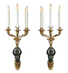 Pair of French 19th Century Neoclassical Style Ormolu and Patinated Sconces