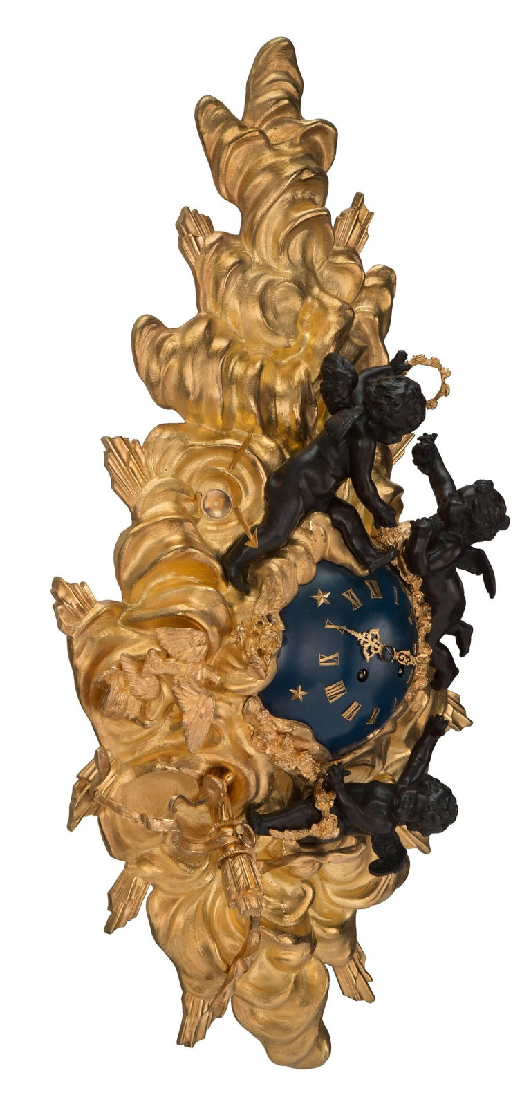 A beautiful French 19th century Louis XV st. ormolu, patinated bronze and blue enamel cartel clock. The clock displays a most elegant and decorative cloud like ormolu design. Decorated with richly chased love birds, arrows, quivers, musical
