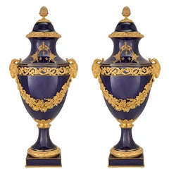 Pair of French 19th Century Louis XVI Style Sèvres Porcelain and Ormolu Urns
