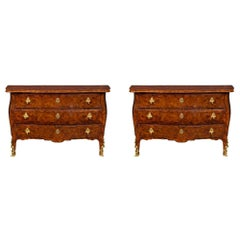 An Italian 19th century  rosewood parquetry and ormolu  three drawer chests.